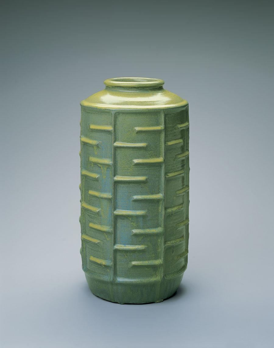 green vase with maze design