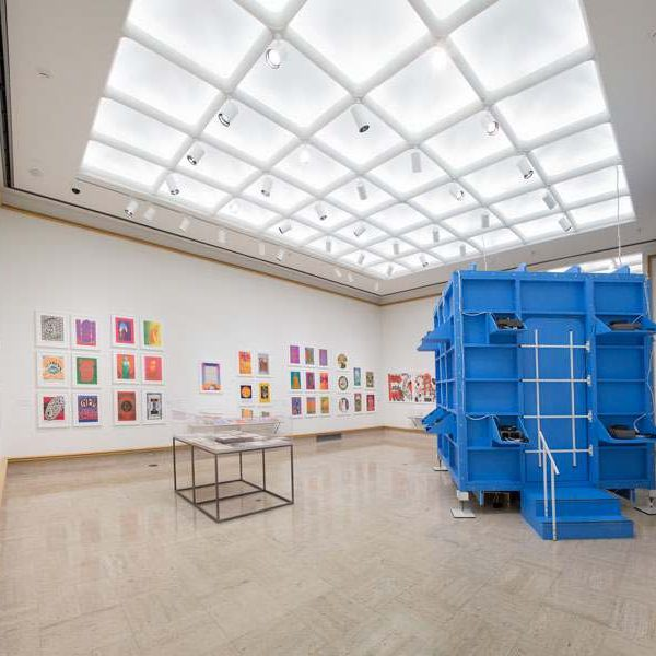 Blue crate sits in white-walled exhibit room