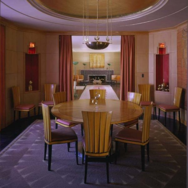 hexagonal dining room with circle table and chairs