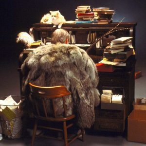 photo of man in fur coat at writing desk (large)