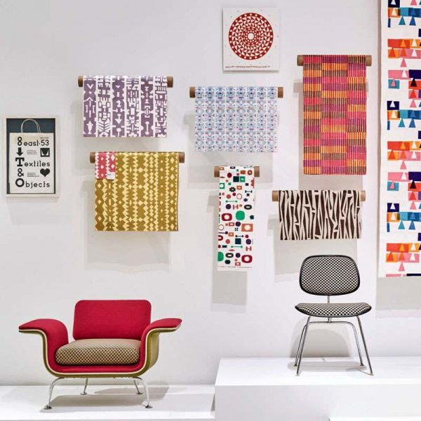 Girard exhibition, chairs and fabric wall hangings (cropped)