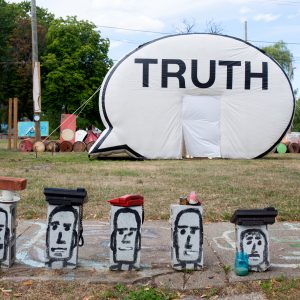 Truth Booth with heads painted on cinder blocks