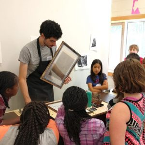 Create Camps teaching students about screen printing
