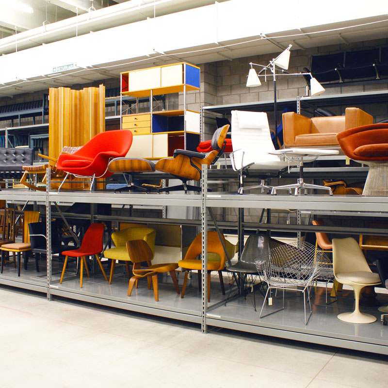 Various chairs on metal shelving