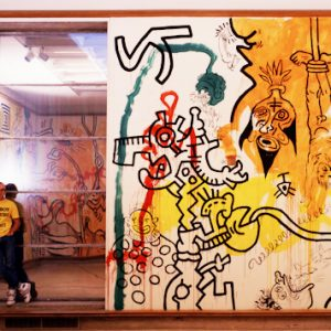 Keith Haring poses with his art