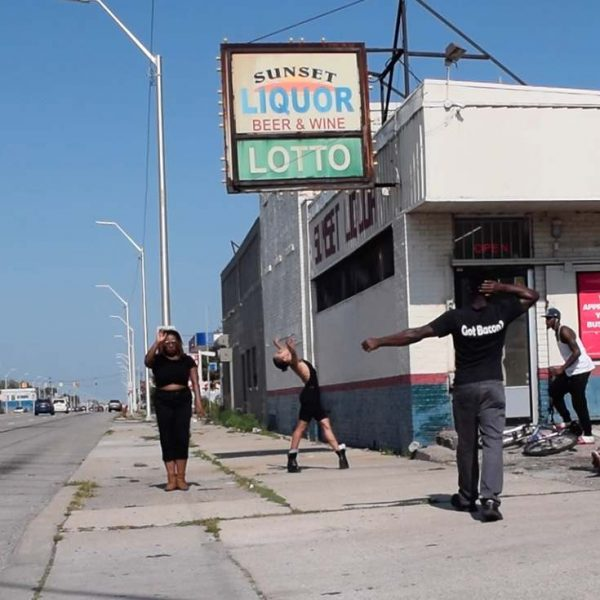 Maya Stovall, people standing in front of sunset liquor store