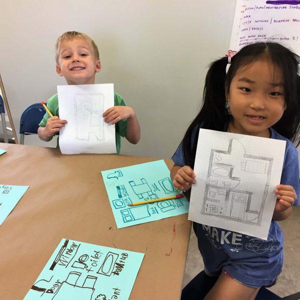 boy and girl show interior design sketches