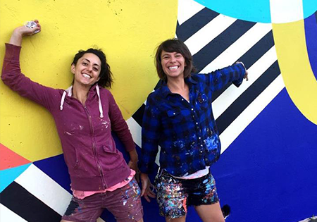 Jessie Unterhalter and Katey Truhn profile against geometric colored wall
