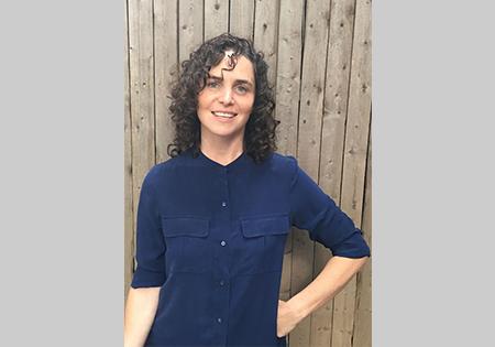 Annie Barrett profile against wooden wall