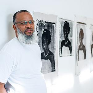 Melenko portrait, white t-shirt on white wall