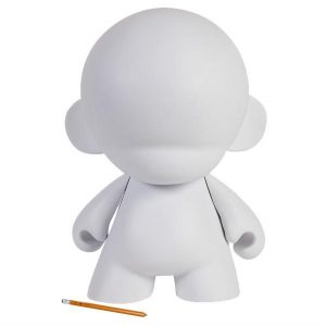 White vinyl figure and pencil