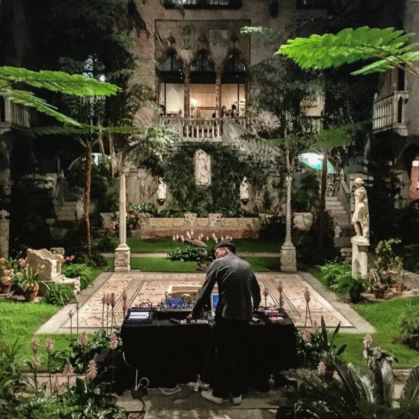 Man standing at table in the middle of a garden
