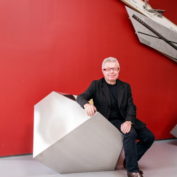 Daniel Libeskind portrait against red wall