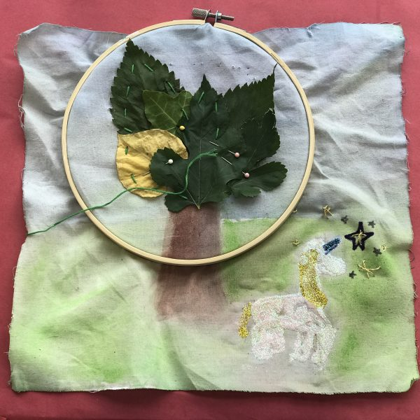 Create Camps, leaves stitched to fabric with unicorn