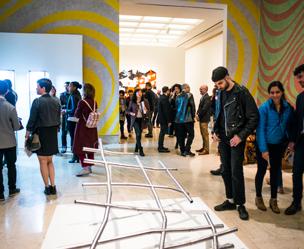 People view pieces at the 2019 Graduate Degree Exhibition