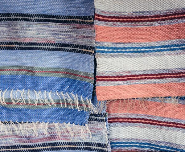 Woven striped fabric with white tassels
