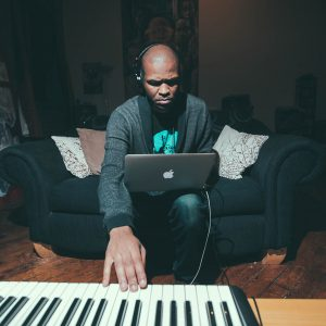 Sterling Toles playing using laptop and keyboard