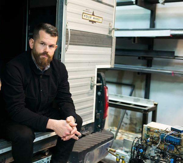 Matthew Day Jackson portrait sitting in a trailer