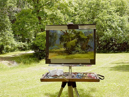 expressive painting of a tree on a standing easel outside